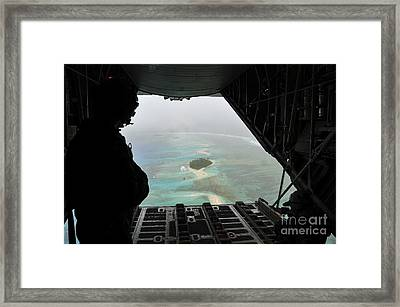 A Bundle Of Donated Goods Drifts To An Framed Print by Stocktrek Images