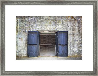 A Bunker With Steel Doors On A Disused Framed Print by Douglas Orton