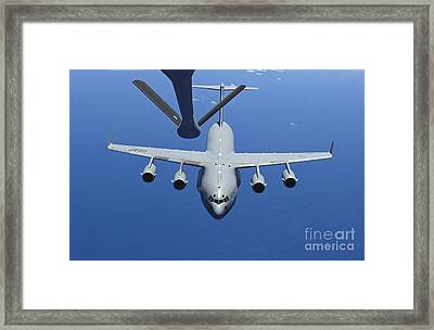 A C-17 Globemaster IIi Approaches Framed Print by Stocktrek Images