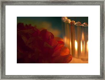 A Candle Glows Framed Print