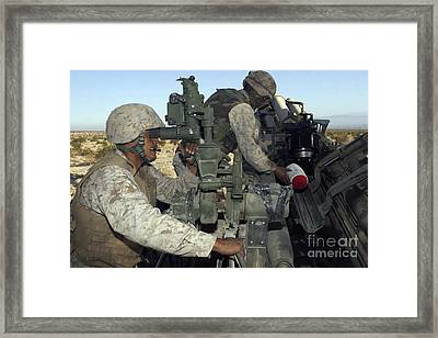 A Cannoneer Looks Through The Sights Framed Print by Stocktrek Images
