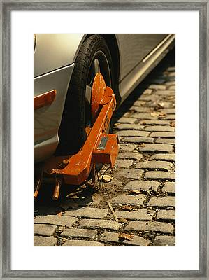 A Car With A Booted Tire Framed Print by Richard Nowitz