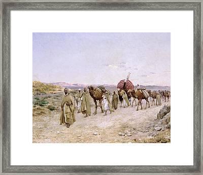 A Caravan Near Biskra Framed Print by PJB Lazerges