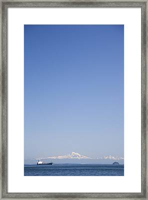 A Cargo Ship Goes Through The Gulf Framed Print by Taylor S. Kennedy