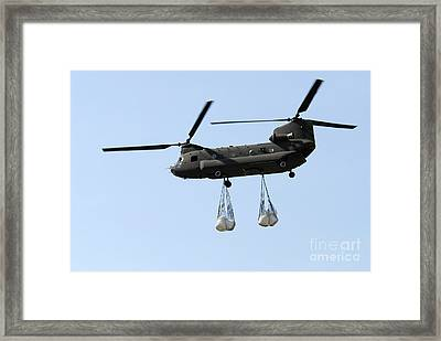 A Ch-47 Chinook Carrying Sandbags Framed Print