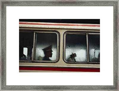 A Chinese Pla Soldier Sits On A Bus Framed Print by Justin Guariglia