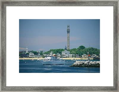 A Cityscape View Of Pilgrim Monument Framed Print by Michael Melford