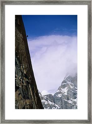 A Climber Rappels Down The Sheer Framed Print by Bill Hatcher