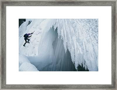 A Climber Scales An Ice Formation Framed Print