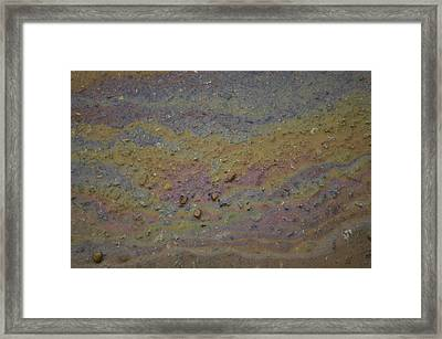A Close-up Of A Parking Lot Oil Slick Framed Print