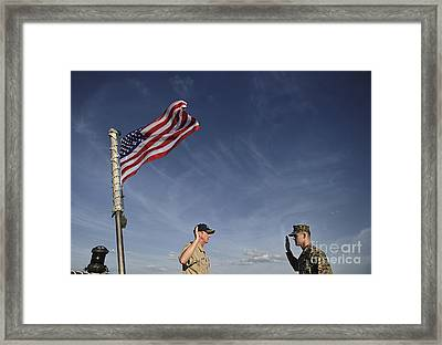 A Commander Administers The Oath Framed Print by Stocktrek Images