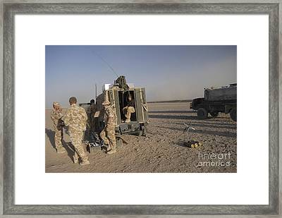 A Control Center For The Howitzer 105mm Framed Print