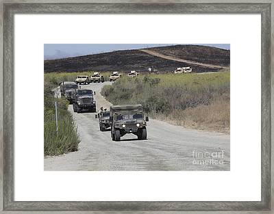 A Convoy Of Military Vehicles Framed Print by Stocktrek Images