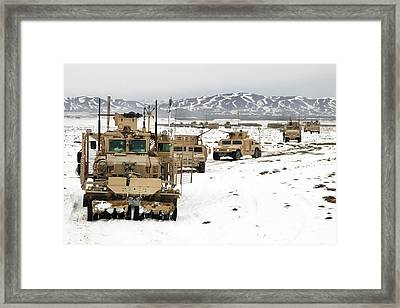 A Convoy Of Vehicles During A Route Framed Print by Stocktrek Images