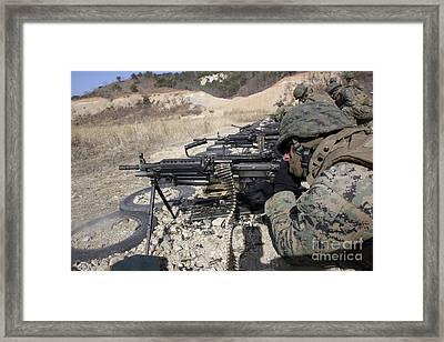 A Corpsman Fires An M249 Squad Framed Print