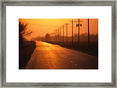A Country Highway Fades Into The Sunset Framed Print by Joel Sartore