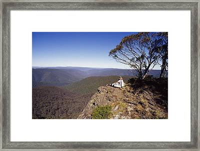 A Couple Embraces Whilst Resting Framed Print by Jason Edwards