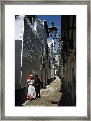 A Couple Lingers On The Sunny Side Framed Print by Luis Marden