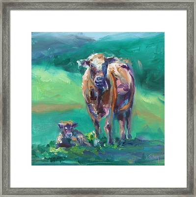 A Cow And Her Calf Framed Print by Donna Tuten