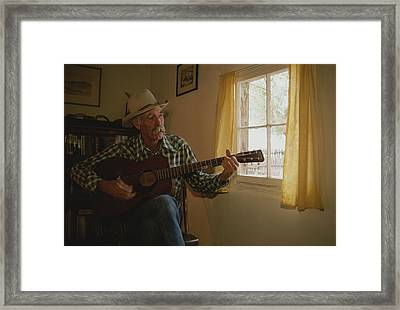 A Cowboy Entertains With His Guitar Framed Print by Stacy Gold