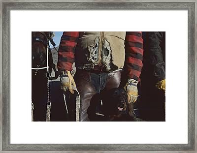 A Cowboy, Wearing A Ripped Jacket Framed Print by Joel Sartore