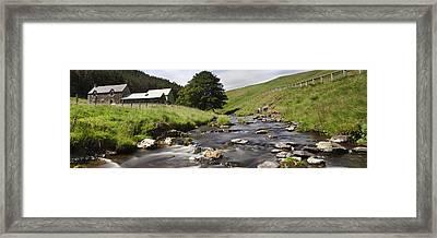 A Creek Running Past Houses Cheviot Framed Print