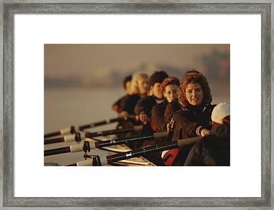 A Crew Team Paddles In Unison Framed Print by Sam Kittner