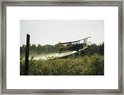 A Crop Dusting Airplane Flys Low Framed Print by Bill Curtsinger