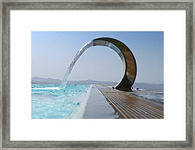 A Curved Stainless Steel Water Fountain Framed Print by Corepics