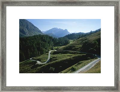 A Curving Mountain Road Outside St Framed Print by Taylor S. Kennedy