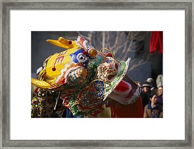 A Dancing Dragon Or Lion Dancers Framed Print by Nadia M.B. Hughes