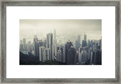 A Daytime City Skyline In Hong Kong Framed Print by Michael Sugrue