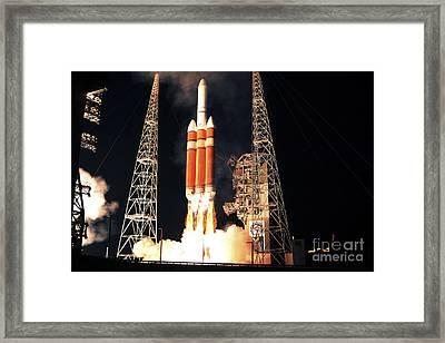 A Delta Iv Heavy Rocket Lifts Off Framed Print by Stocktrek Images