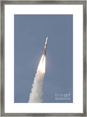 A Delta Iv Rocket Roars Into The Sky Framed Print by Stocktrek Images
