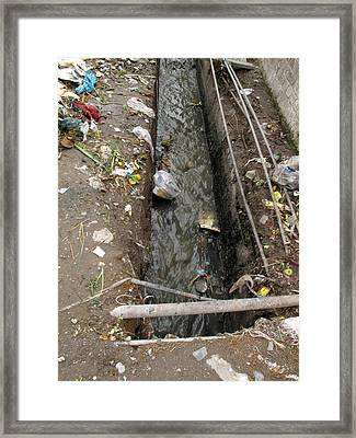 Framed Print featuring the photograph A Dirty Drain With Filth All Around It Representing A Health Risk by Ashish Agarwal