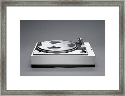 A Disk With A Soccer Print On A Record Player Framed Print by Benne Ochs