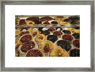 A Display Case Full Of Fruit Pastries Framed Print