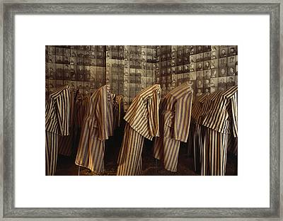 A Display Of Photographs And Uniforms Framed Print by James L. Stanfield