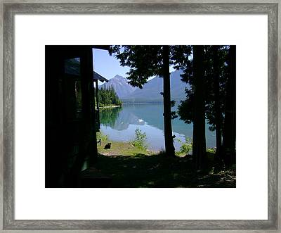 A Dog And A Cabin On A Lake  Framed Print by John Harrison