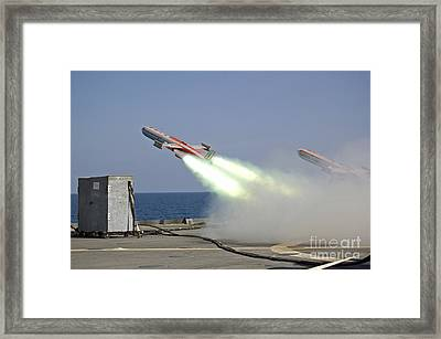 A Drone Is Launched From The Amphibious Framed Print by Stocktrek Images