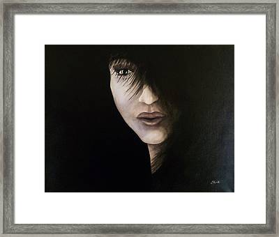 A Face In The Shadows  Framed Print
