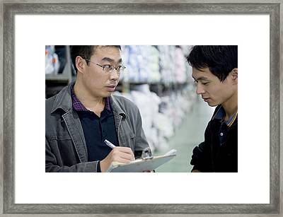A Factory Employees Discuss Textile Framed Print by Justin Guariglia