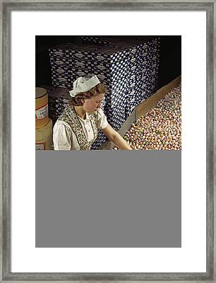 A Factory Worker Sorts Through Candy Framed Print