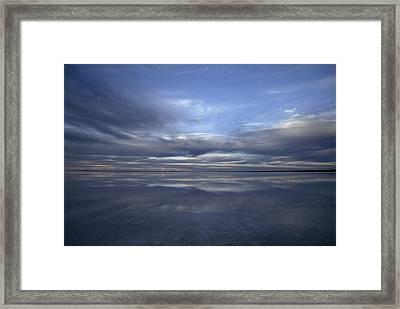 A Fading Sunset Reflects Off The Still Framed Print by Jason Edwards