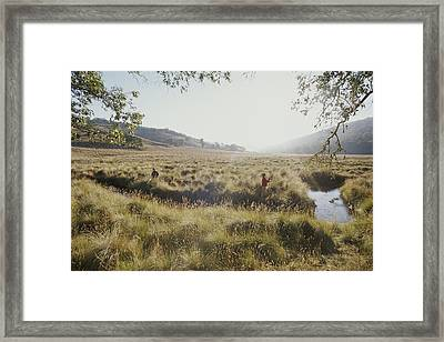 A Father And Daughter Fly Fish Together Framed Print