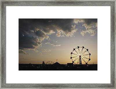 A Ferris Wheel Is Silhouetted Framed Print by Stephen Alvarez