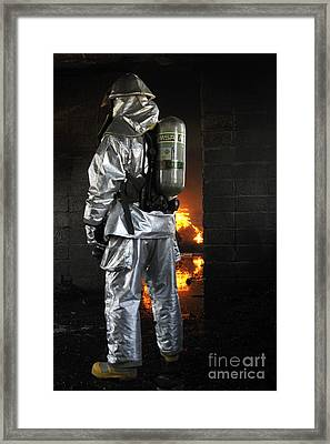 A Firefighter Waits For A Fire To Get Framed Print by Stocktrek Images