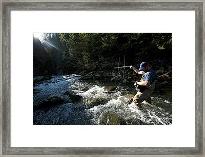 A Fisheries Technician Uses An Antenna Framed Print by Joel Sartore