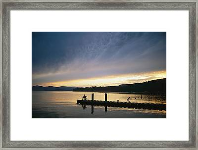 A Fisherman At Dawn Tries His Luck Framed Print by Michael S. Lewis