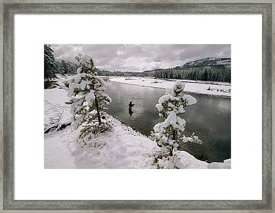 A Fisherman Tries His Luck Framed Print by Annie Griffiths